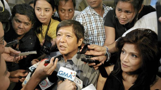 In the thick of it … Bongbong and Imee Marcos (at right) surrounded by reporters in 2009.