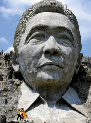 Rock and rolled … a Mount Rushmore-like sculpture of Ferdinand Marcos at Marcos Park in Pugo, before it was destroyed in ...