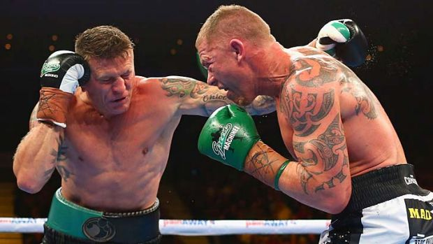 Danny Green and Shane Cameron exchange blows.