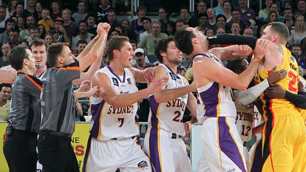 Tigers import Seth Scott tangles with Kings centre Ian Crosswhite at Hisense Arena during their spiteful NBL clash on Sunday.