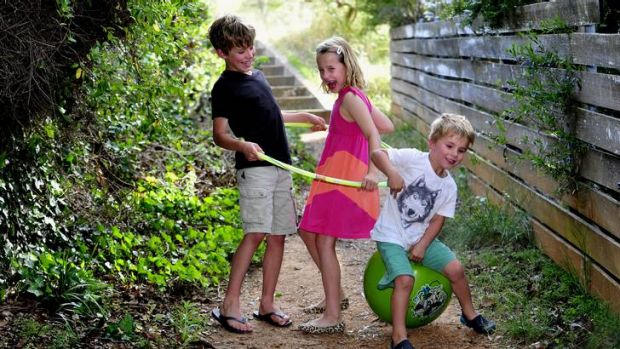 Mac Stephen, 8,  playing with his sister  Emily, 7, and brother Will, 4.