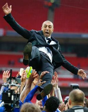 How quickly he forgets ... Chelsea coach Roberto Di Matteo is thrown in the air by players after their FA Cup final ...
