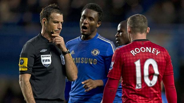 A picture taken on October 28, 2012 shows Chelsea's Nigerian midfielder John Mikel Obi (second left) talking with ...