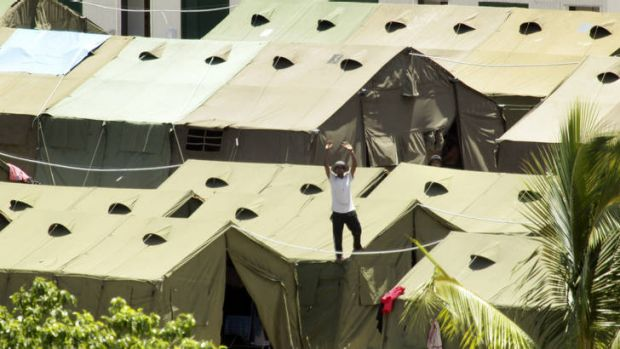 A refugee at the Nauru detention centre protest with signs and chants of freedom.  A view of the Nauru detention centre ...