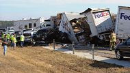 Cars and Trucks are piled on Interstate 10