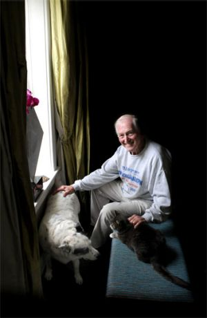 Courtenay at home with his beloved pets earlier this year.