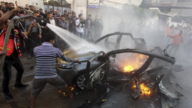 Self-defence or opening the gates of hell ... the scene after an Israeli air strike killed  Hamas's top commander Ahmed ...