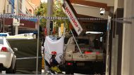 Police have a shot a man outside a pub in Redfern. The man, who is believed to be in his 40s, was driving a small work ...