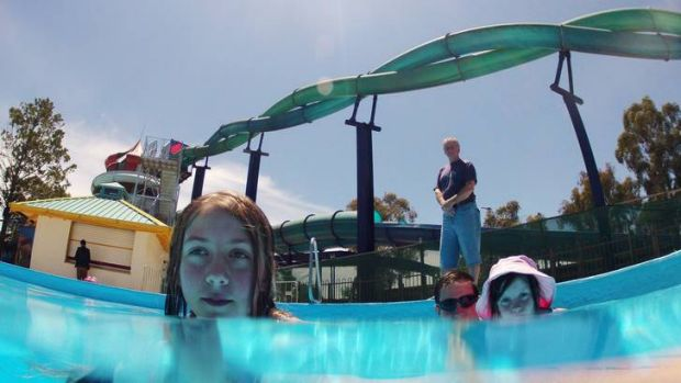 Owner of Big Splash Waterpark Ron Watkins (rear) and customers Madeleine, 10, father Dave and Rachel Cummings, 8.