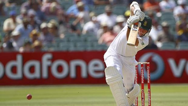 Striking … Graeme Smith drives the ball on his way to a century on the second day of the Adelaide Test.