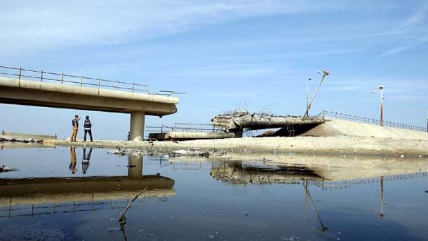 A destroyed bridge is seen after what witnesses said was a hit by an Israeli air strike in central Gaza Strip