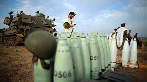 Hold your fire ... Israeli soldiers stop for a dawn prayer service at an artillery camp close to the Gaza border.