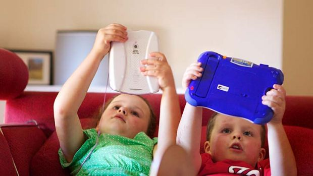 Yasmin and Seamus with their gadgets. Their mother, Danielle Chapman, says she is frequently engaged in an iPad ...