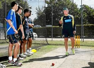 Former Australian fast bowler Craig McDermott coaching at a cricket clinic with ACT U-15 and U- 7 players at Manuka Oval ...