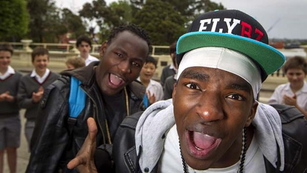 Rhyming the wrongs ... Fablice and G-Storm of hip-hop act the Flybz at Melbourne's Xavier College. The pair are refugees ...