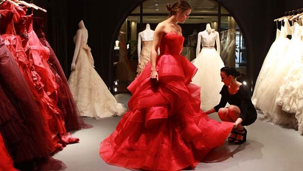 Splash of colour ... Amy Jenkins tries on a dress with the help of Alana Patience at Vera Wang in Sydney.