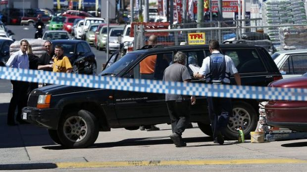 Police at the scene of a accident at the Woden Magnet Mart carpark where a pedestrian was hit, and eventually died, in ...