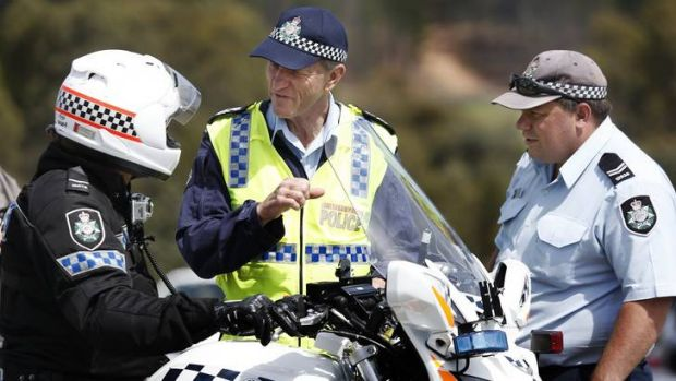 Senior Constable Bret Marro, left, from the Traffic Operations chats with Sergeant Dick Dauth and Senior Constable ...