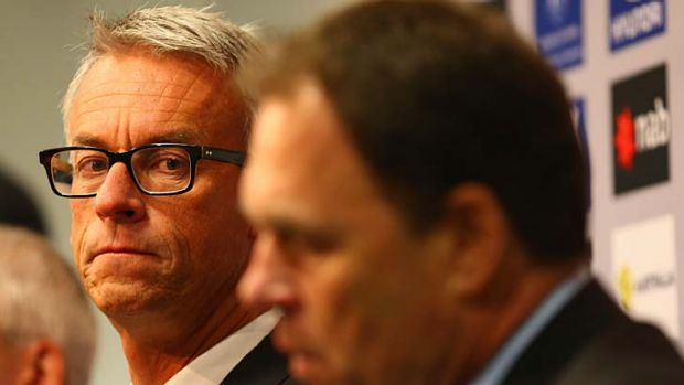 All positive … David Gallop listens to coach Holger Osieck.