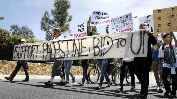 Supporters for Palestine rights march out the front of the Embassy of Israel in Yarralumla.