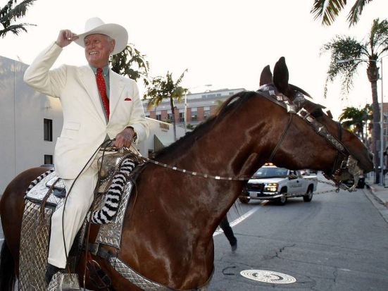 Larry Hagman rides a horse as he arrives for a VIP preview party for the Collection of Larry Hagman at Julien's Auctions ...