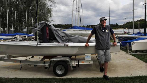 Fred Kasparek of the Canberra Yacht Club attends to his boat.