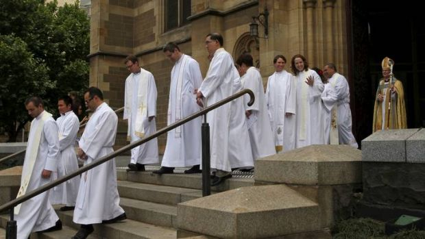 Archbishop Philip Freier follows the priests he ordained before a large congregation at St Paul's Anglican Cathedral.