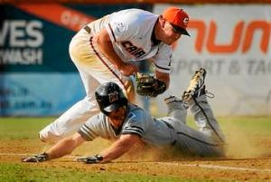 Canberra Cavalry's Michael Wells claims the scalp of Aces' Scott Wearne at Narrabundah Ballpark on Saturday.