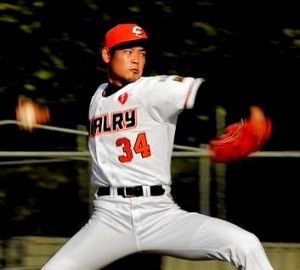 Canberra Cavalry pitcher Hirokazu Shiranita winds up for a pitch.