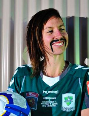 Canberra United soccer player Sally Shipard sports a fake moustache.