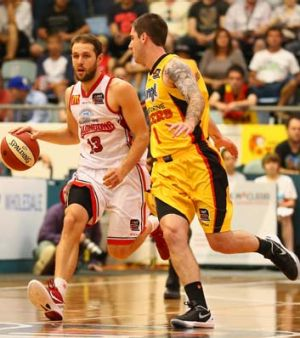 Wollongong's Rhys Martin takes on Nate Tomlinson.