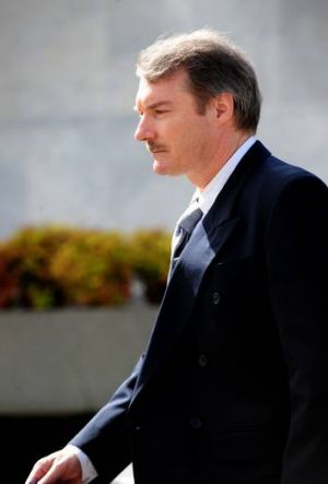 Letter bomber Colin Dunstan leaves the Supreme Court in Canberra, 2010. He is accusing Comcare of defying a court order ...