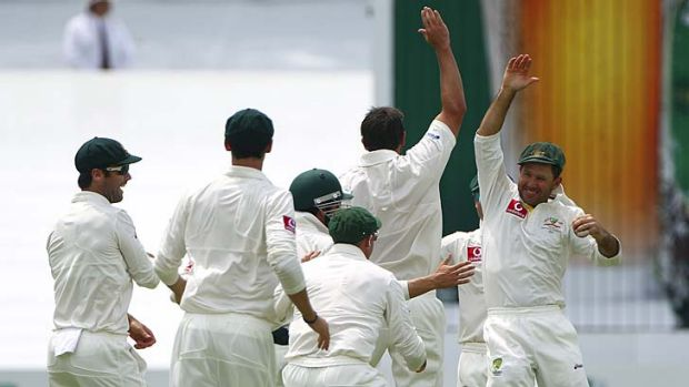 Six more to go ... the Australian team celebrate the wicket of South Africa's Graeme Smith on Sunday.