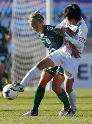Canberra United's Georgia Yeoman-Dale pressures Maya Doko of Japan's NTV Beleza.