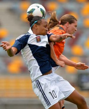 Tussle ... The Roar's Lana Harch and Melbourne's Jessica McDonald challenge for the ball during Brisbane's 3-2 win.