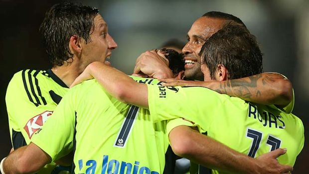 Well-earned ... 10-man Melbourne Victory celebrate their victory over Western Sydney.