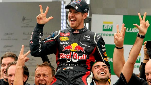 Three-peat ... Sebastian Vettel celebrates his F-1 World Championship with Red Bull teammates.