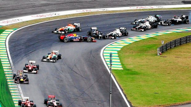 Hit and spin ... Vettel collides with Bruno Senna.