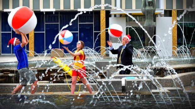 From left, Sean Hodges, Dana Simonsen and Stephen Gregory promote Canberra's 12-day Christmas Carnival.