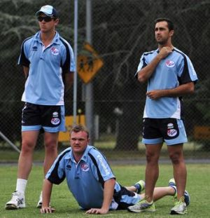 NSW bowlers Josh Hazlewood, Doug Bollinger and Josh Lalor during a training session at Manuka Oval.