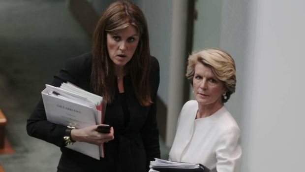 Opposition Leader Tony Abbott's chief of staff Peta Credlin speaks with Deputy Opposition Leader Julie Bishop on Monday.