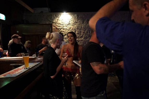 Fever Burlesque performer Cleo talking to the locals during a break in the show in Picton.