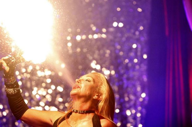 Lady D playing with fire during her performance.