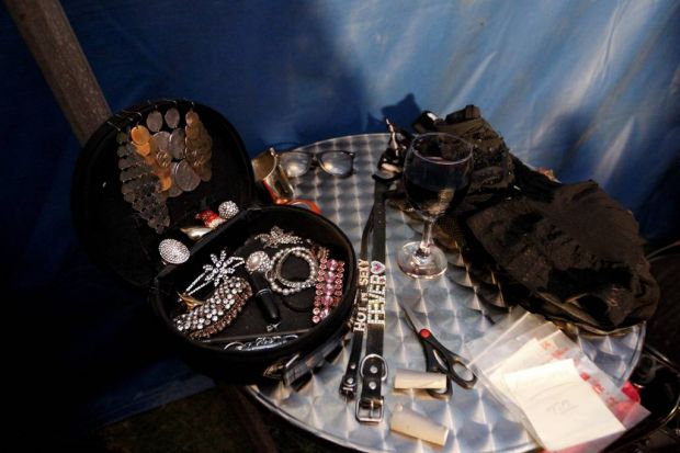 Costume pieces all around in the back stage tent.