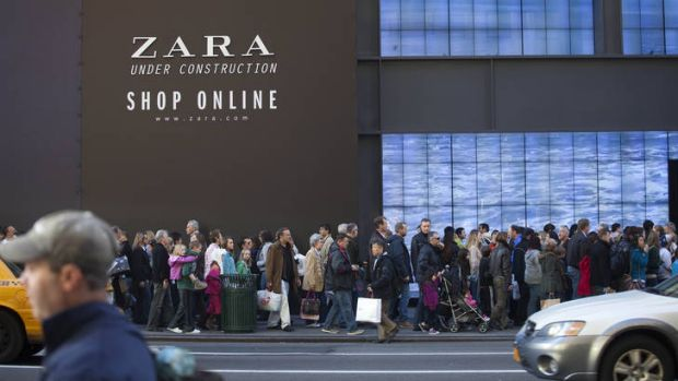 Pedestrians and shoppers fill the footpath on New York City's Fifth Avenue on 'Black Friday'.