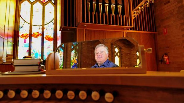 Chris Erskine is as excited as a boy with a new toy with the grand new organ at Saint Paul's Anglican church, Manuka.