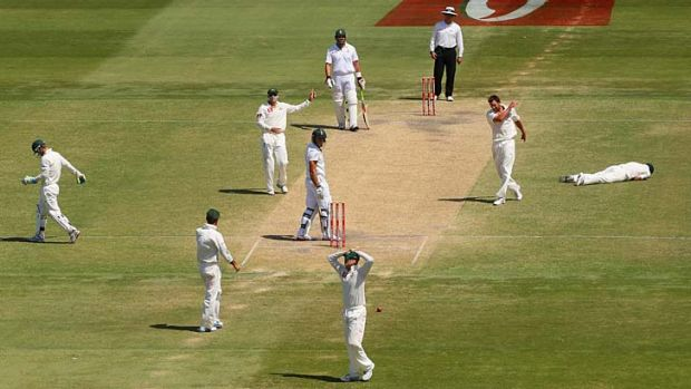 Oh no! Australian fieldsmen show their emotions as wicketkeeper Matthew Wade spills a chance to dismiss Faf du Plessis.