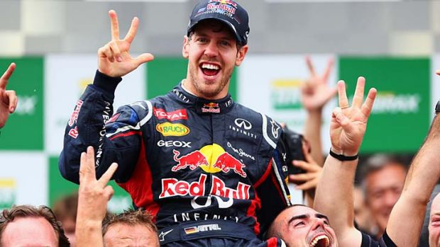 Three-peat … Red Bull's Sebastian Vettel celebrates his third straight drivers' championship after finishing sixth ...