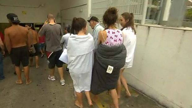 Schoolies leave an evacuated building.