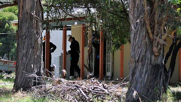 Detectives from the organised crime squad's chemical operations team investigate the property.